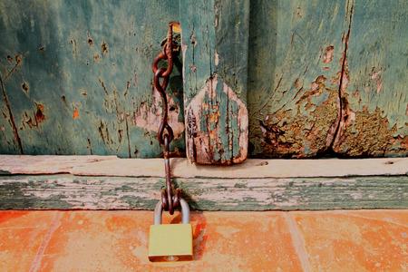 Old lock on green wooden door  photo