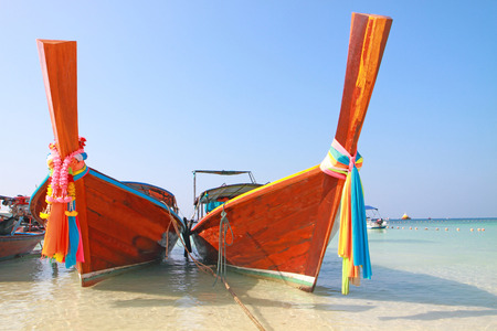 long tailed boat: Long tailed boat on the beach in Lipe  island, Andaman sea, Thailand.