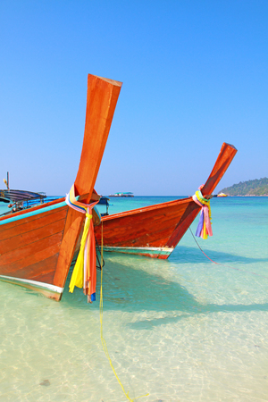 Long tailed boat on the beach in Lipe  island, Andaman sea, Thailand. photo