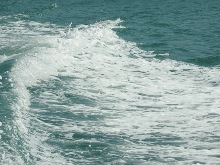 Foamy wake behind the stern of the ship Stock Photo