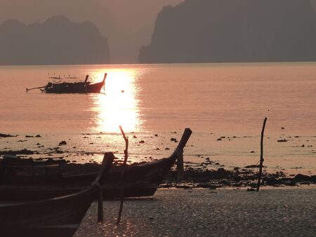 local fishing boat at on sunrise in Phang-Nga,Thailand Stock Photo