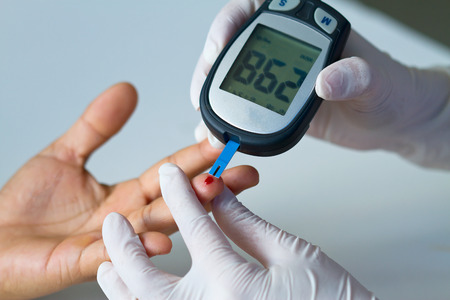 blood glucose meter, the blood sugar value is measured on a finge photo