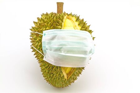 smelly: Smelly durian wear mask isolated on white background Stock Photo