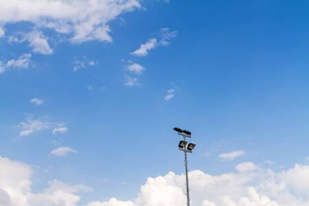 lambent: A football stadium sport light with blue sky