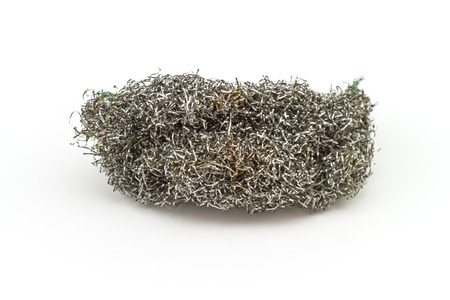 scour: Old steel wool pad on white background Stock Photo