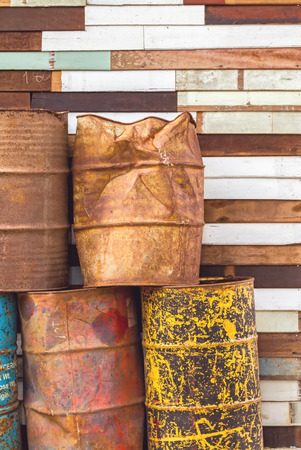 altogether: old fuel tanks that lay altogether and grunge wooden background Stock Photo