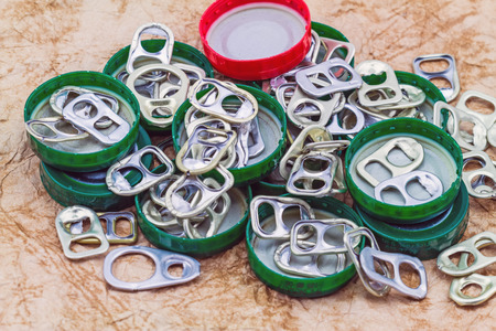 ring pull: Ring pull aluminum of cans on grunge paper sheet background Stock Photo