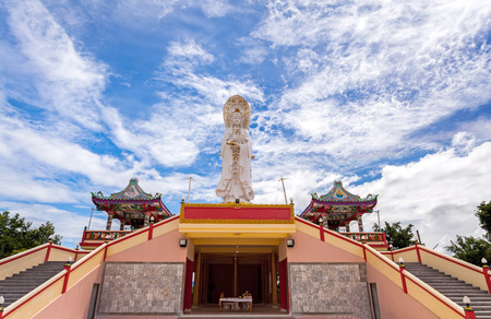 generality: Chinese temple in Thailand  under the blue sky and big  cloud  Generality in Thailand ,and kind of art decorated in Buddhist church, temple pavilion ,temple hall . They are public