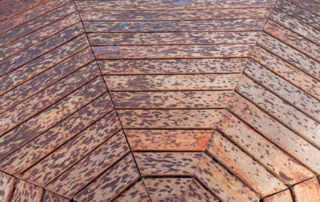diamond shaped: Weathered wooden square with textured grain and X -  shaped or diamond  -  shaped pattern