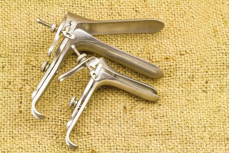 gynecologic: Medical equipment ,Gynecologic Speculum on brown sack fabric background