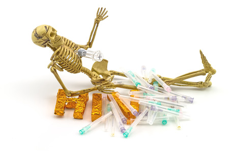 indicate: Still  life concept human body bone  ,syringe stabbing chest ,needles  and  A word HIV  on white background indicate danger of AIDS
