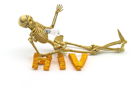indicate: Still  life concept human body bone  ,syringe stabbing chest and  A word HIV  on white background indicate danger of AIDS