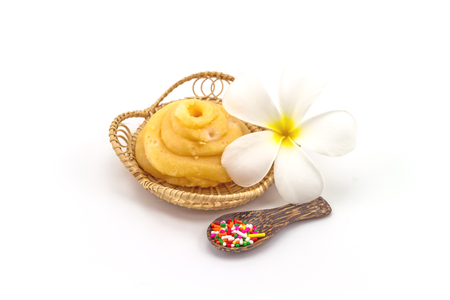 palmyra palm: Palmyra Palm Borassus flabellifer Linn. Palmae Jaggery or sugar from palm or coconut , frangipani flowers sprinkle sugar and wooden spoon in Rattan weave mat on white background