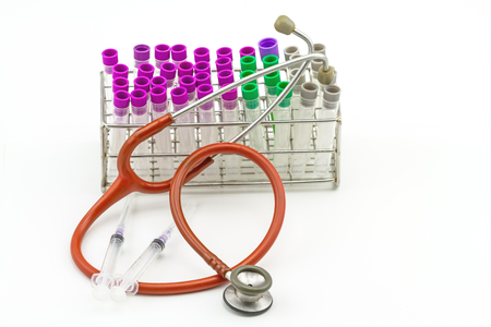 anticoagulant: Medical Blood tube, test tube for laboratory empty on  rack  and pink stethoscope and disposable syringe on a while background