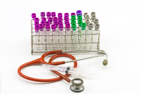 phlebotomy: Medical Blood tube, test tube for laboratory empty on  rack  and pink stethoscope and disposable syringe on a while background