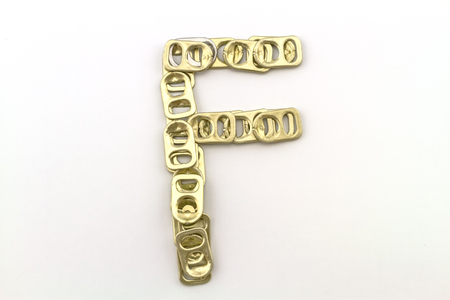 ring pull: Alphabet  of F stack from  ring pull aluminum of cans on white background