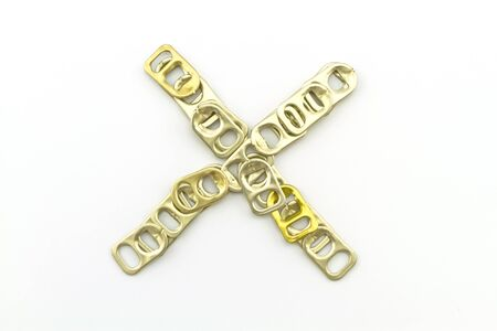 ring pull: Alphabet  of X stack from  ring pull aluminum of cans on white background Stock Photo