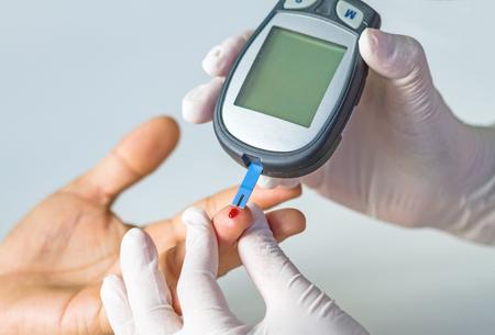 blood glucose meter, the blood sugar value is measured on a finger