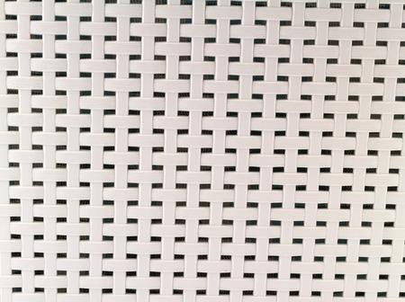 latticework: A chair white basket weave pattern