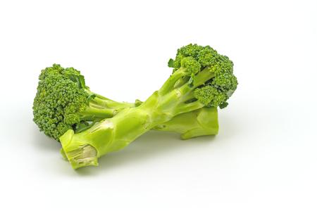 long stem: Green fresh broccoli  on white background Stock Photo