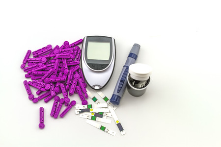 measured: blood glucose meter, the blood sugar value is measured on a finger on white background. Stock Photo