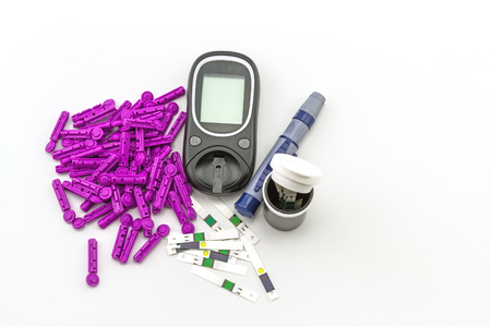 self exam: blood glucose meter, the blood sugar value is measured on a finger on white background. Stock Photo