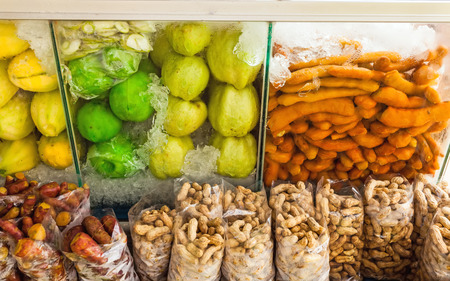 cold storage: Group of fresh and preserve fruits mango , guava , tamarind , bean , yam  on cold storage box in the market