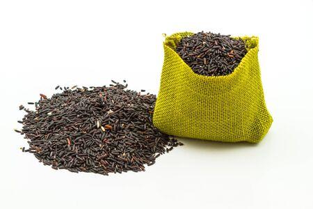 sisal: Rice berry in green sisal sack on white background Stock Photo