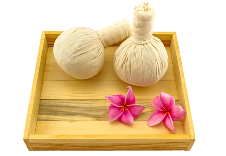 apocynaceae: Spa herbal compressing ball , pink frangipani flowers Plumeria spp , Apocynaceae, Pagoda tree, Temple tree in wooden box isolate on white background