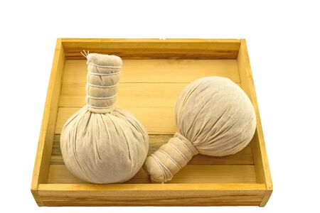 herbal background: Spa herbal compressing ball in wooden box isolate on white background