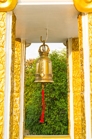 generality: Giant golden  bell and red cotton  in the temple at  Thailand( Generality in Thailand ,and kind of art decorated in Buddhist church, temple pavilion ,temple hall . They are public