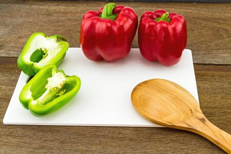 colorful still life: still - life concept colorful sweet bell pepper capsicum   in white block   on wooden background