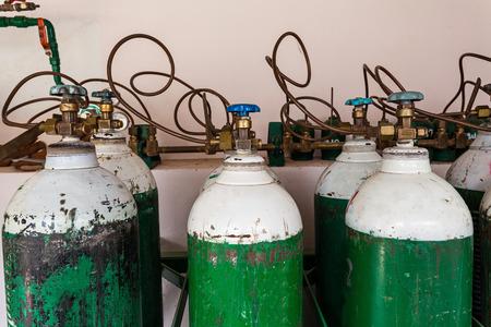 upright row: Oxygen supply tanks