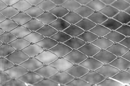 tine: wire fence on brown cement background
