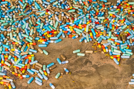 expire: Many colorful medicines expire on cement floor