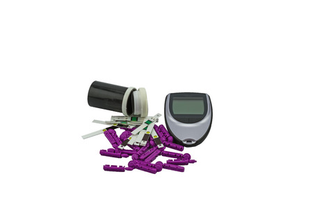 blood glucose meter: Many strip test of blood glucose meter, the blood sugar value is measured on a finger on white background