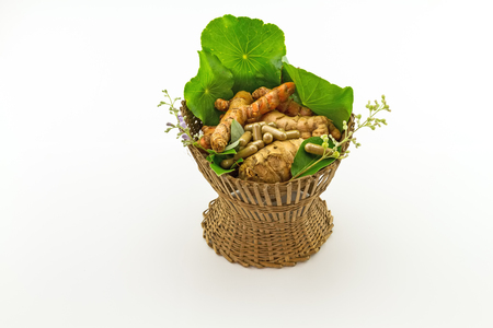 trifolia: Assorted of herbal in brown bamboo basket   isolate on white background
