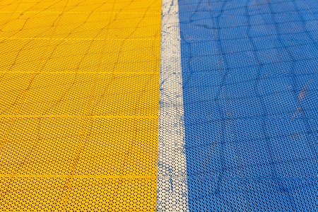 futsal: Blue and yellow rubber flooring on Futsal field background