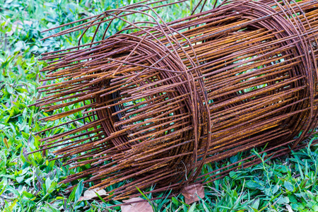 joist: Old Steel rod for construction on green grass Stock Photo