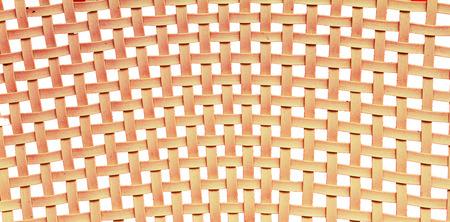 A chair white white basket weave pattern