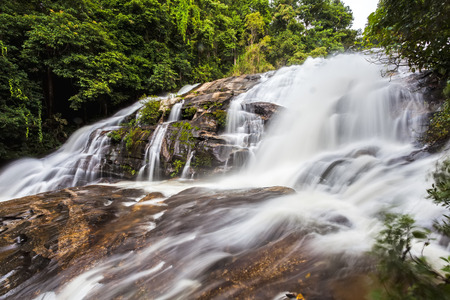 jung: Motion blurred water of Pa Dok Siew Waterfall (Rak Jung waterfall ) beautiful waterfall in deep forest  Doi Inthanon national park . Chiangmai , Thailand