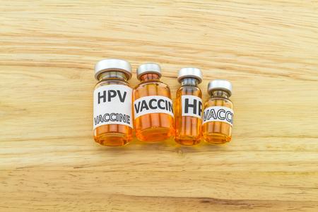 Bottle vaccine of Human papillomavirus (HPV) vaccine on wooden background