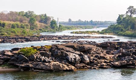swiftly: River flow through the rocks at Kaeng Tana, Ubon Ratchathani, Thailand Stock Photo