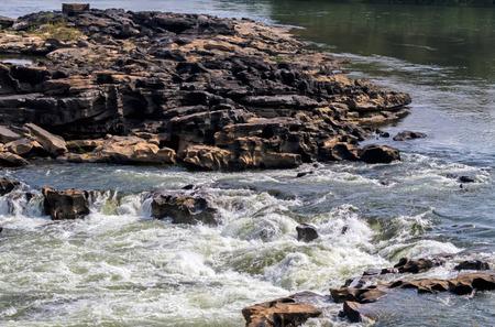 River flow through the rocks at Kaeng Tana, Ubon Ratchathani, Thailand Stock Photo