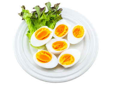 duck egg: Close up medium soft boiled duck egg portion and green salad in white dish on white background.Saved with clipping path.