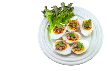 Close up salted egg salad , mix many vegetable ,Mix boiled egg ,Thai food in white dish on white background.Saved with clipping path.