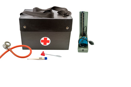 health care provider: Close up home call, doctors bag and equipment for health examination (old style blood pressure monitor tool or manometers,stethoscope ,knee jerk ,Thermometer ) isolated on white background. Stock Photo