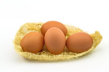 luffa: Eggs in luffa on white background