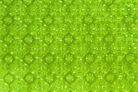 Blurry of  green corrugated glass pattern use for background