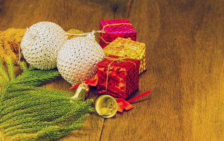 Still life concept green pine ,disco ball  ,gift set box , a candle stack on black wooden in Christmas day Stock Photo